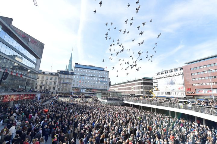 "Thousands of people packed Stockholm's center square in a ""Lovefest"" vigil against terrorism on Sunday."