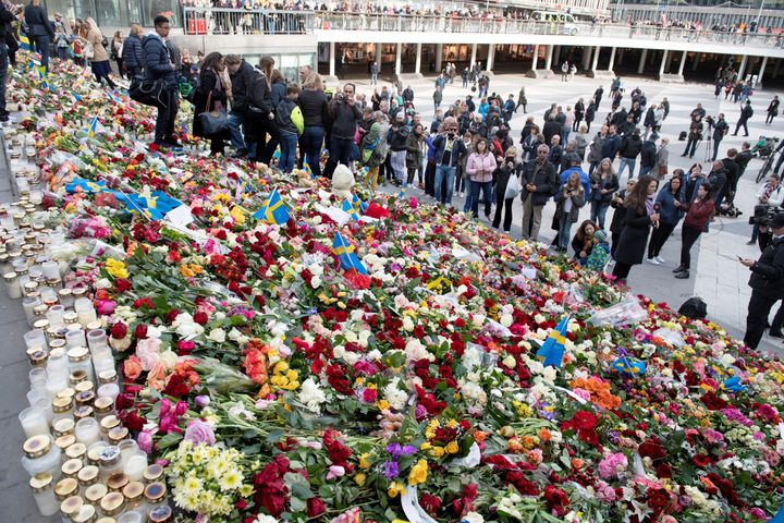 Steps along Sergels Torg, Stockholm's center square, are seen covered in vibrant flowers after Friday's deadly attack that le