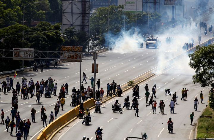 Demonstrators clash with riot police during a rally in Caracas.