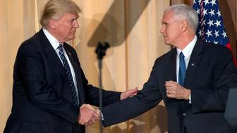WASHINGTON, DC - MARCH 28:  US President Donald Trump, left, shakes hands with US Vice President Mike Pence, right, prior to signing an Energy Independence Executive Order at the Environmental Protection Agency (EPA) Headquarters on March 28, 2017 in Washington, DC. The order reverses the Obama-era climate change policies.  (Photo by Ron Sach-Pool/Getty Images)