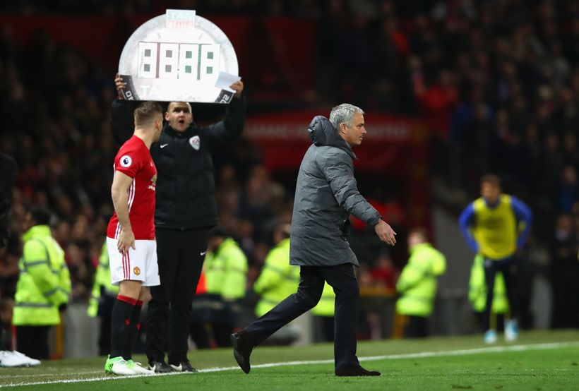 Jose Mourinho approaches the pitch as defender Luke Shaw prepares to come on for United against Everton.