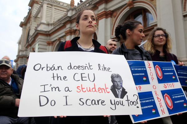 A student in Budapest holds up a sign featuring Hungarian Prime Minister Viktor Orban.