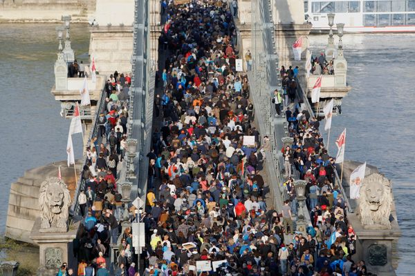 People protest on Chain Bridge.