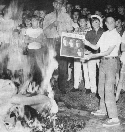 Young people burning Beatles records.