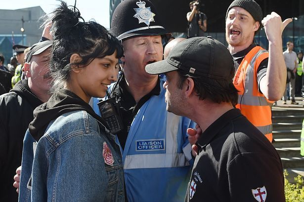 Saffiyah Khan smiling at the face of the EDL leader.
