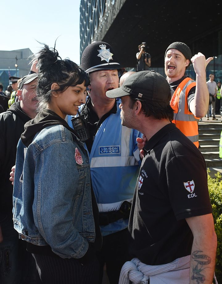 File photo dated 08/04/17 of Saffiyah Khan (left) staring down English Defence League (EDL) protester Ian Crossland during a