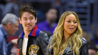 LOS ANGELES, CA - FEBRUARY 15:  Mariah Carey (L) and Bryan Tanaka attend a basketball game between the Atlanta Hawks and the Los Angeles Clippers at Staples Center on February 15, 2017 in Los Angeles, California.  (Photo by Noel Vasquez/Getty Images)