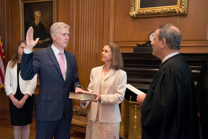 Chief Justice John Roberts administers the constitutional oath to Neil Gorsuch, President Donald Trump's Supreme Court nomine