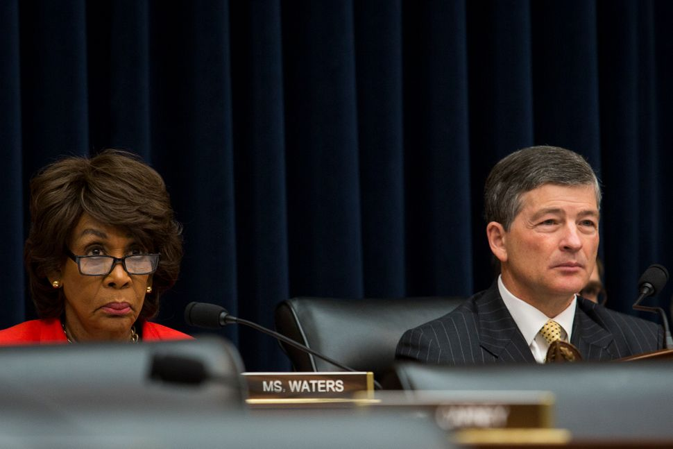 Waters and Financial Services Committee Chairman Jeb Hensarling (R-Texas) listen to testimony during a hearing.