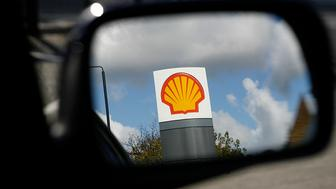 UNITED KINGDOM - OCTOBER 27:  The Shell logo reflected in a car mirror at a Shell station in London, U.K., on Monday, Oct. 27, 2008. Royal Dutch Shell Plc, Europe's biggest oil company, said third-quarter profit climbed 22 percent as record crude oil prices offset production cuts in Nigeria and the Gulf of Mexico.  (Photo by Jason Alden/Bloomberg via Getty Images)