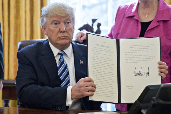 "Trump holds up a signed executive order entitled ""Preventing Violence Against Federal, State, Tribal and Local Law Enforcemen"
