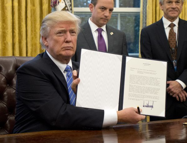"Trump holds an executive order titled ""Mexico City Policy,"" which bans federal funds going to overseas organizations that per"