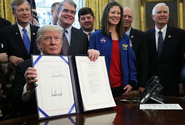 Trump signed a bill authorizing funding for NASA in a bill signing ceremony as NASA astronaut Tracy Caldwell Dyson (4th L) an