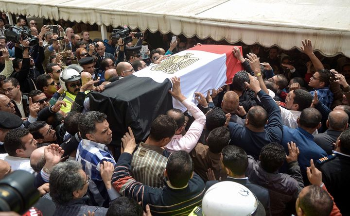 Egyptians carry the coffin of policewoman Brigadier Nagwa el-Haggar during her funeral on April 10, 2017, after she died duri