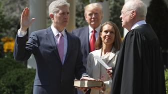 WASHINGTON, DC - APRIL 10:  U.S. Supreme Court Associate Justice Anthony Kennedy (R) administers the judicial oath to Judge Neil Gorsuch as his wife Marie Louise Gorsuch holds a bible and President Donald Trump looks on during a ceremony in the Rose Garden at the White House April 10, 2017 in Washington, DC. Earlier in the day Gorsuch, 49, was sworn in as the 113th Associate Justice in a private ceremony at the Supreme Court.  (Photo by Chip Somodevilla/Getty Images)