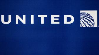 The new United Continental Holdings Inc. logo is displayed at George Bush Intercontinental Airport in Houston, Texas, U.S., on Monday, Feb. 14, 2011. United Continental Holdings distributed $224 million in profit-sharing checks to employees based on 2010 profits. Photographer: Aaron M. Sprecher/Bloomberg via Getty Images
