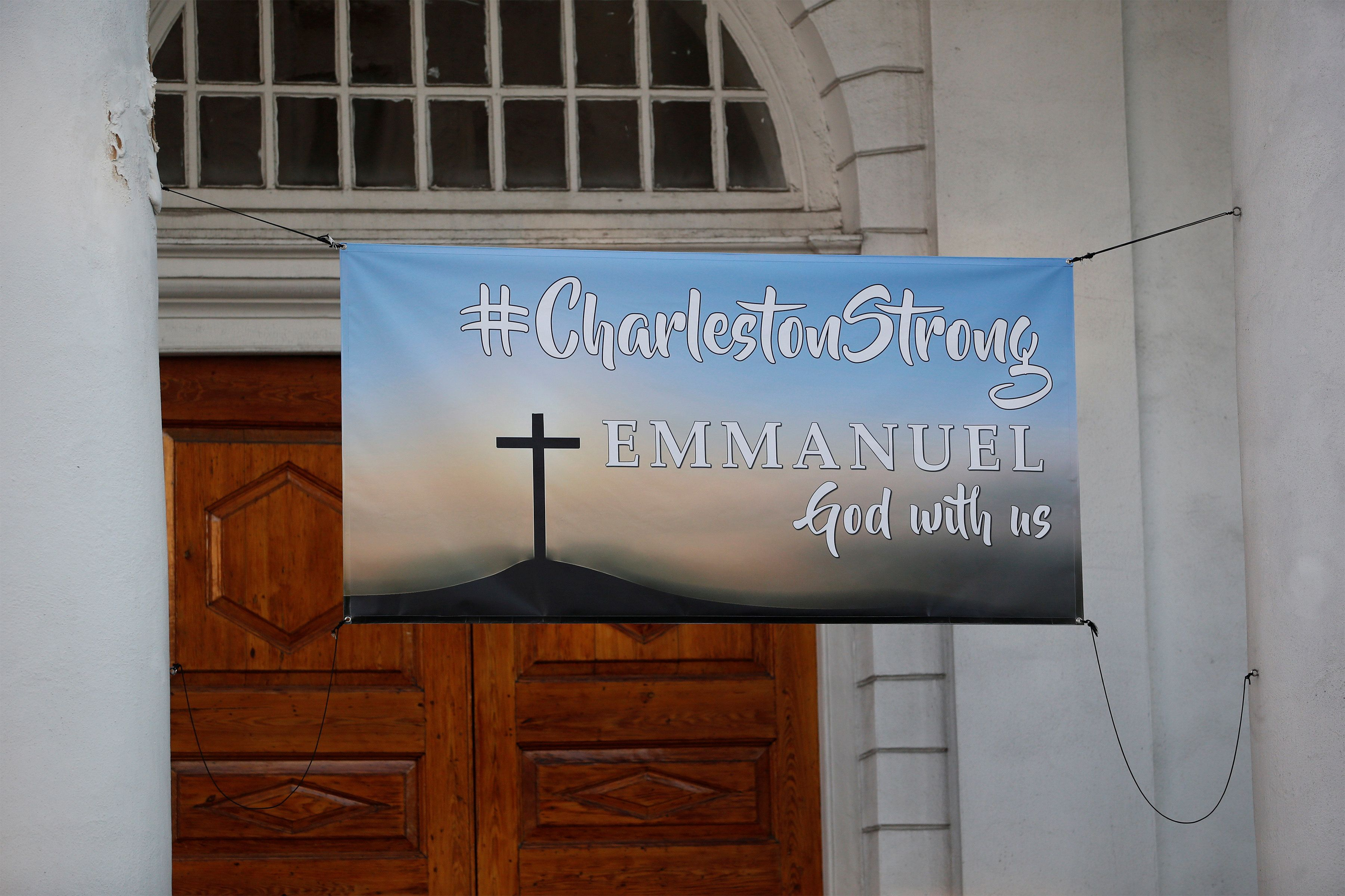 A Charleston Strong banner hangs from a church across from the Charleston Federal Courthouse during the federal trial of Dyla