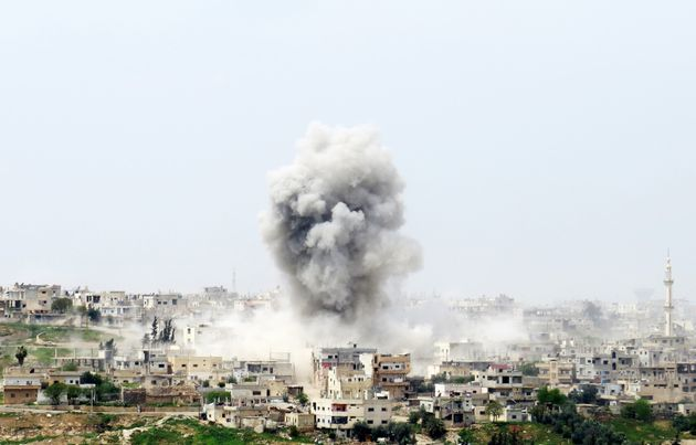 Smoke rises after Syrian Regime Forces bombed the Menshiyye neighborhood as opposition forces advance...