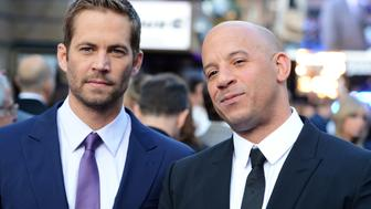 LONDON, ENGLAND - MAY 07:  (L-R) Paul Walker and Vin Diesel attend the world premiere of 'Fast And Furious 6' at The Empire Leicester Square on May 7, 2013 in London, England.  (Photo by Dave J Hogan/Getty Images)