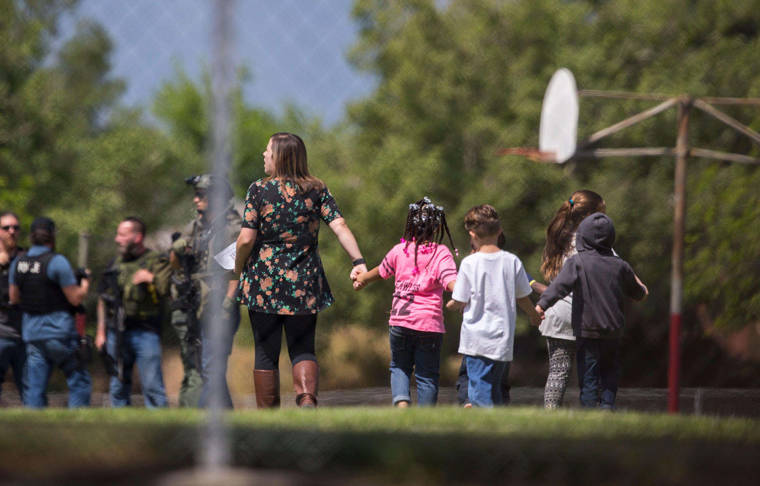 SAN BERNARDINO, CA - APRIL 10: Evacuated children hold hands on the playground after a shooting inside North Park Elementary School on April 10, 2017 in San Bernardino, California. (Photo by Gina Ferazzi/Los Angeles Times via Getty Images)