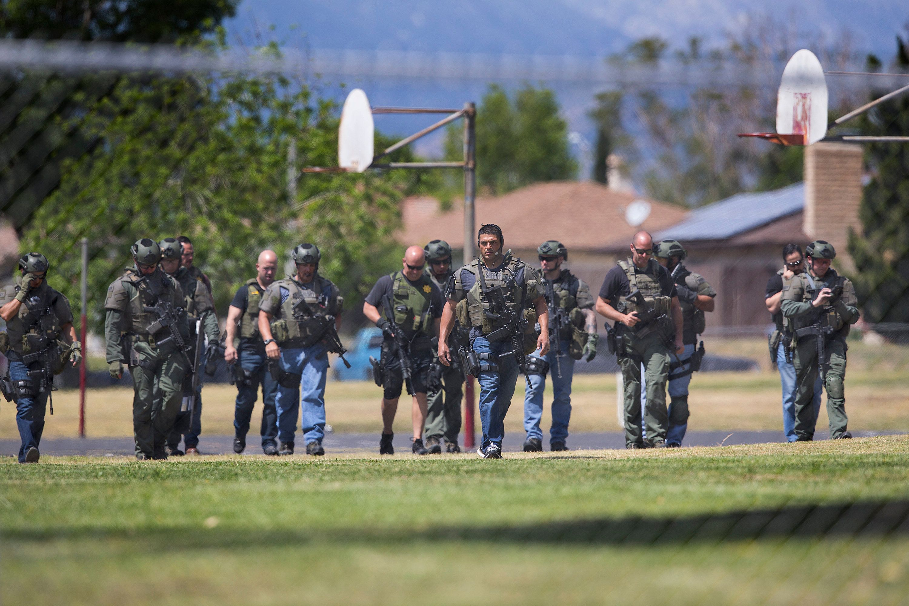SAN BERNARDINO, CA - APRIL 10:  SWAT officers walk through the playground after a shooting inside North Park Elementary School on April 10, 2017 in San Bernardino, California. (Photo by Gina Ferazzi/Los Angeles Times via Getty Images)