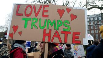 Stop Trumps Muslim ban demonstration on 4th February 2017 in front of the US Embassy in Grosvenor Square, London, United Kingdom. The protest was called on by Stop the War Coalition, Stand Up to Racism, Muslim Association of Britain, Muslim Engagement and Development, the Muslim Council of Britain, CND and Friends of Al-Aqsa. Thousands of demonstrators gathered to demonstrate against Trump's ban on Muslims, saying it must be opposed by all who are against racism and support basic human rights, and for Theresa May not to collude with him. A woman holds a placard saying 'Love Trumps Hate'.(photo by Jenny Matthews/In Pictures via Getty Images)