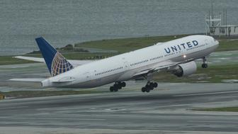 A United Airlines Boeing 777 takes off at San Francisco International Airport's runway 10L. (Photo by Yichuan Cao/NurPhoto via Getty Images)