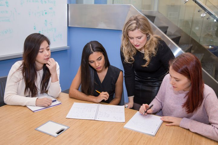 <p>Dr. Powers working with students through Powers Education</p>
