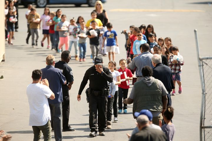 Children were forced to leave their classrooms following a deadly school shooting in San Bernardino, California, on April 10,