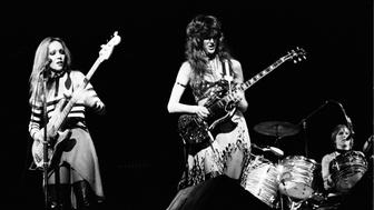 LONDON - 1st JANUARY: Jean Millington (left) and Patti Quatro from American rock group Fanny perform live on stage at the Rainbow Theatre in London in 1974. (Photo by Erica Echenberg/Redferns)
