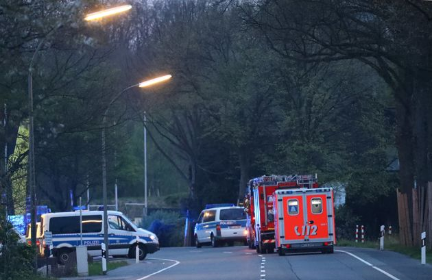 Police and emergency vehicles are seen after the