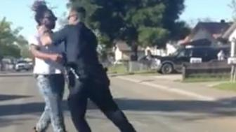 A Sacramento police officer is under investigation for tackling and striking a black man who had allegedly jaywalked