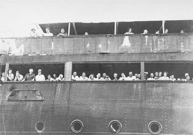 Jewish refugees aboard the St. Louis attempt to communicate with friends and relatives in Cuba, who were...