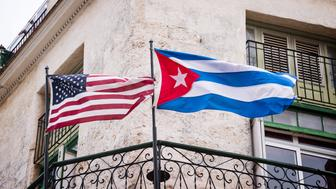 US and Cuban flags side by side in Havana, Cuba