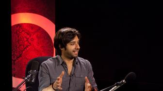 CBC radio personality Jian Gomeshi (left) speaks with star reader Askon Hobooti (right) in the Q studio at CBC headquarters in Toronto on Thursday, July 12, 2012. (Photo by Pawel Dwulit/Toronto Star via Getty Images)