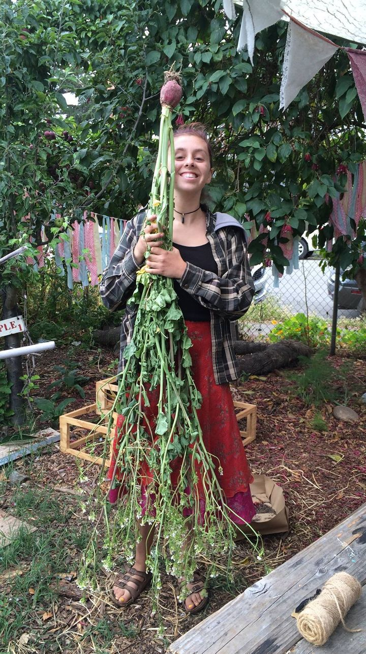 Senior, Alex Raffanti, shows off one of the many vegetables harvested in the garden.
