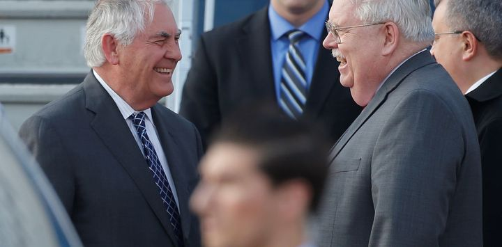 U.S. Secretary of State Rex Tillerson is welcomed by U.S. Ambassador to Russia John Tefft.