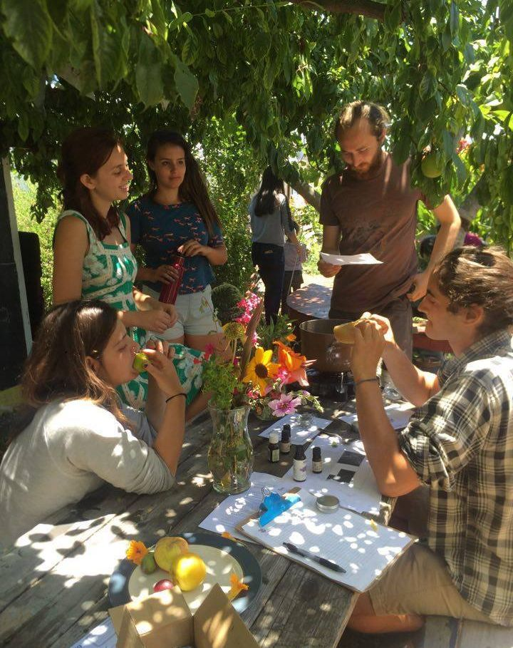 A few students attend a workshop at the garden.