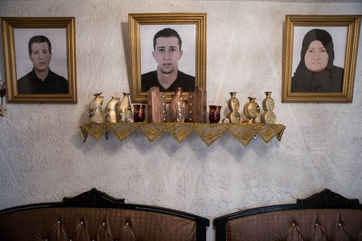 A portrait of Mohammad (center), who left Tunisia to join an extremist group in Syria and never returned, hangs in his family's house in the Ettadhamen neighborhood of Tunis.