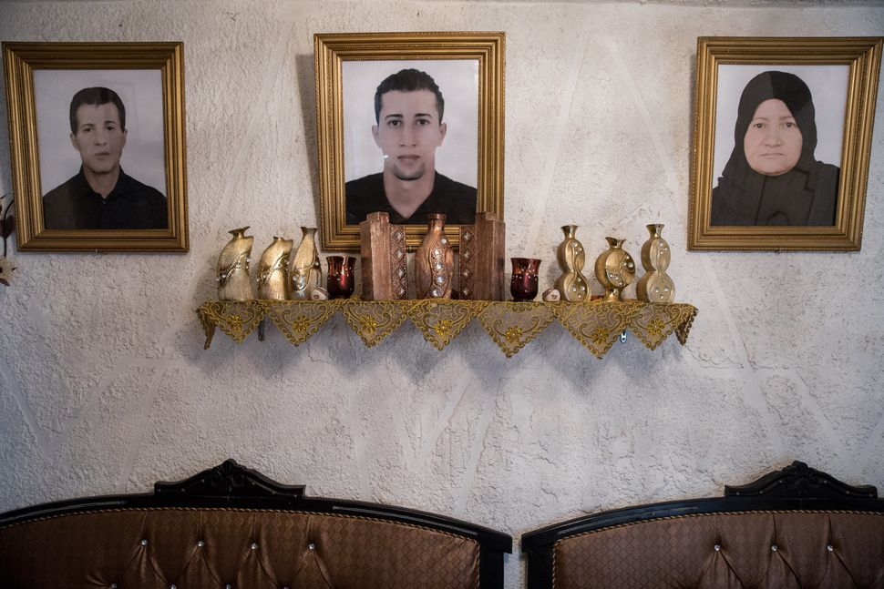 A portrait of Mohammad (center), who left Tunisia to join an extremist group in Syria and never returned, hangs in his family