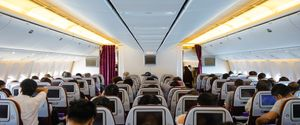 JET BAND TRAVEL SERVICE CABIN PEOPLE TRAVELING VEHICLE INTERIOR GROUP OF PEOPLE MIDAIR EXIT SIGN CONFINED SPACE ENCLOSURE AIRBUS FLYING MOVIE
