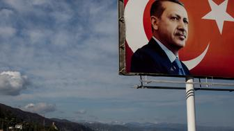 RIZE, TURKEY - APRIL 10:  A 'EVET' (Yes) campaign billboard showing the portrait of Turkish President Recep Tayyip Erdogan is seen on April 10, 2017 in Rize, Turkey. Although born in Kasimpasa, Istanbul, President Erdogan's family was originally from Rize a conservative town on the Black Sea. His family returned to Rize when Erdogan was very young staying until he was 13, before returning to Istanbul. Campaigning by both the 'Evet'(Yes) and 'Hayir' (No) camps has intensified across the country ahead of Turkey holding a constitutional referendum on April 16, 2017. Turks will vote on 18 proposed amendments to the Constitution of Turkey. The controversial changes seek to replace the parliamentary system and move to a presidential system, which would give President Recep Tayyip Erdogan executive authority.  (Photo by Chris McGrath/Getty Images)