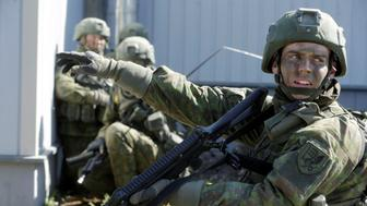 Lithuanian army soldiers attend the Spring Storm military exercise near the Estonia's eastern border in Rapina, Estonia, May 13, 2016. REUTERS/Ints Kalnins/File Photo