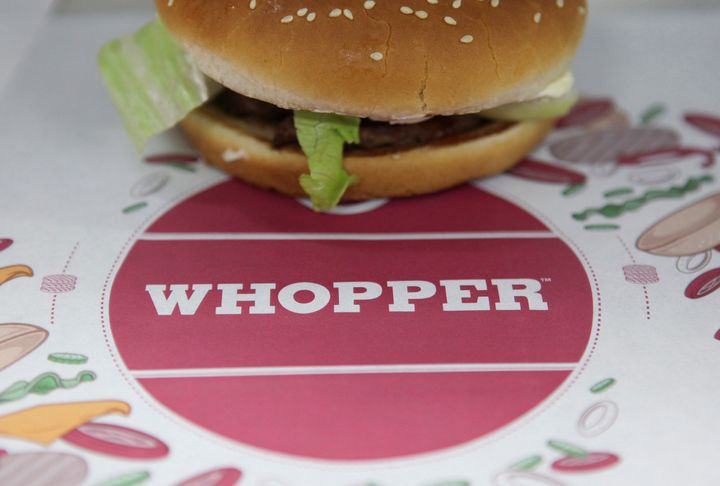 The 15-second video ad for Burger King's Whopper sandwich, pictured, is designed to trigger viewers' Google Home devices to describe the burger in detail.
