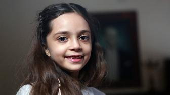 Syrian girl Bana al-Abed, known as Aleppo's tweeting girl, poses during an interview in Ankara, Turkey, on December 22, 2016. The young Syrian girl was one of thousands of people evacuated from once rebel-held areas of Aleppo in the last days under a deal brokered by Turkey and Russia. She was evacuated on Monday and Turkish officials promised then she would come to Turkey with her family. But it was not clear when she had crossed over. / AFP / ADEM ALTAN        (Photo credit should read ADEM ALTAN/AFP/Getty Images)
