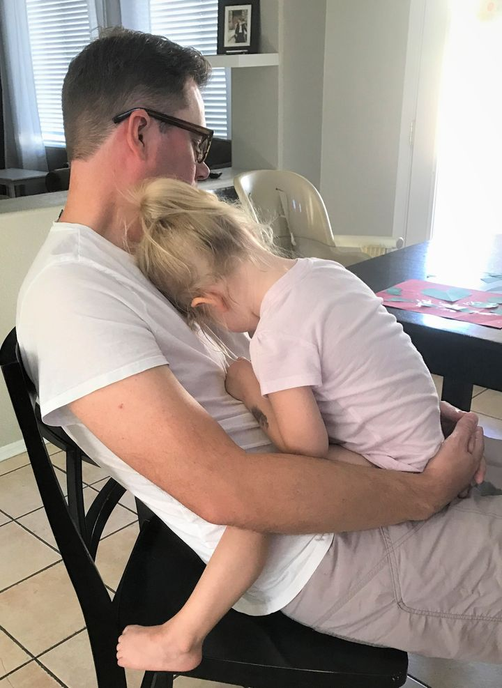 <p>Daddy's snuggles are every bit as good as mommy's—especially when you have the stomach flu.</p>