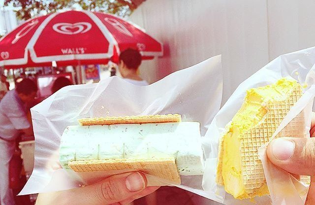 Ice cream uncles in Singapore. You can get your slice of ice cream served between two wafer cookies, as pictured above, or in wrapped in a slice of sweet bread.