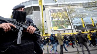 CORRECTION - Police patrols outside the stadium during the UEFA Champions League 1st leg quarter-final football match BVB Borussia Dortmund v Monaco in Dortmund, western Germany on April 12, 2017. / AFP PHOTO / Sascha Schuermann / The erroneous mention[s] appearing in the metadata of this photo by Sascha Schuermann                    has been modified in AFP systems in the following manner: [-Police patrols outside the stadium during the UEFA Champions League 1st leg quarter-final football match BVB Borussia Dortmund v Monaco in Dortmund, western Germany on April 12, 2017.--] instead of [-Police patrols outside the stadium prior to the UEFA Champions League 1st leg quarter-final football match FC Bayern Munich v Real Madrid in Munich, southen Germany on April 12, 2017. --]. Please immediately remove the erroneous mention[s] from all your online services and delete it (them) from your servers. If you have been authorized by AFP to distribute it (them) to third parties, please ensure that the same actions are carried out by them. Failure to promptly comply with these instructions will entail liability on your part for any continued or post notification usage. Therefore we thank you very much for all your attention and prompt action. We are sorry for the inconvenience this notification may cause and remain at your disposal for any further information you may require.        (Photo credit should read SASCHA SCHUERMANN/AFP/Getty Images)