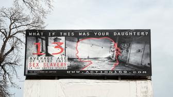 Belle Plaine, Minnesota. Billboard showing the effects of sex slavery in the United States. (Photo by:  Education Images/UIG via Getty Images)