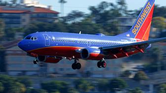 A Southwest Airlines jet comes in to land at Lindbergh Field in San Diego, California February 25, 2015. Southwest Airlines Co said it pulled 128 aircraft out of service on Tuesday after it discovered that they were overdue for a required check of the standby hydraulic system that serves as a backup to the planes' primary systems.  REUTERS/Mike Blake (UNITED STATES - Tags: TRANSPORT BUSINESS)